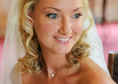 Beautiful natural wedding make-up and half up down hair style.
