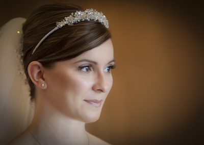 Stunning natural wedding make-up with hair styled in a french pleat.