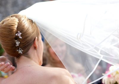 Wedding hair up style pleat.