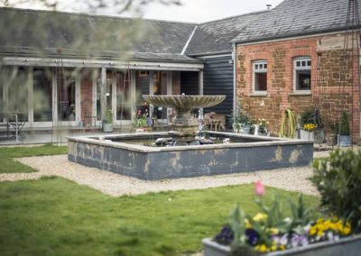 Ash Tree Barns courtyard fountain, photo by Lucy Dack Photography